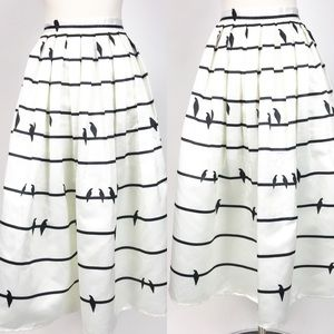 Chicwish Pleated bird skirt sing a love song xxl